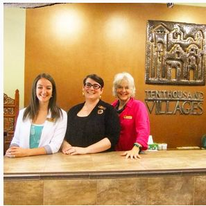 photo of employees at front desk